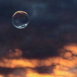 sunset sphere sea clouds