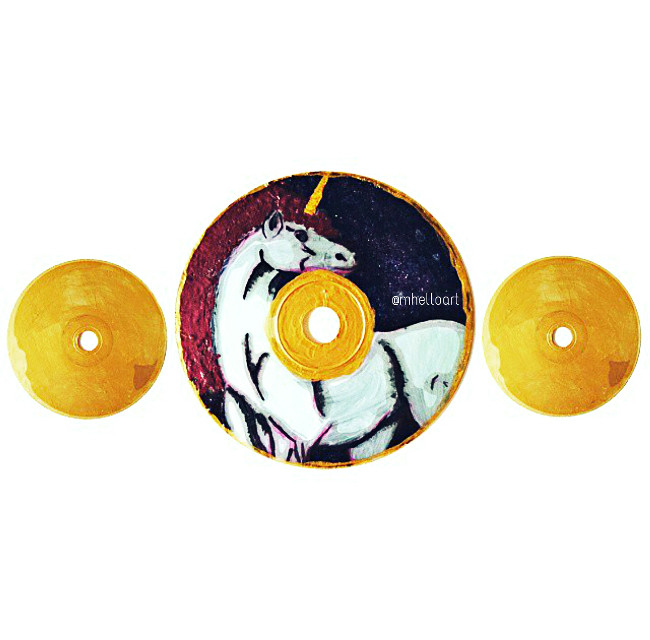 A unicorn done in acrylics, on an old CD.  #unicorn #horse #cartoon #repurposed #old #new #cd #gold #inspired #paintings #painting #acrylic #acrylics #popart #paint #unicorns #mythical #creatures #mythicalcreatures #fable #tale